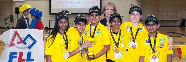 six teenagers in yellow shirts from a lego team